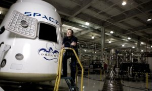 Elon Musk with Dragon capsule